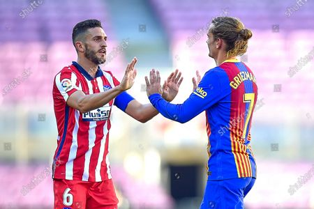 Stock Photo of Antoine Griezmann of FC Barcelona and Koke Resurreccion of Atletico de Madrid at full time