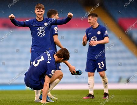 Chelsea's Timo Werner and Chelsea's Marcos Alonso celebrate after winning the English Premier League soccer match between Manchester City and Chelsea at the Etihad Stadium in Manchester