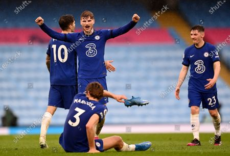 Chelsea's Timo Werner, centre, and Chelsea's Marcos Alonso, front, celebrate after winning the English Premier League soccer match between Manchester City and Chelsea at the Etihad Stadium in Manchester