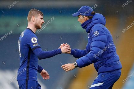 Chelsea's Timo Werner, left, and Chelsea's head coach Thomas Tuchel celebrate winning the English Premier League soccer match between Manchester City and Chelsea at the Etihad Stadium in Manchester