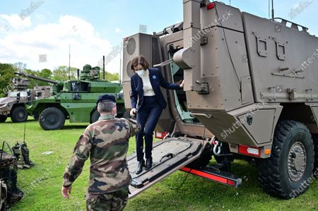 Stock Picture of French Defense Minister Florence Parly steps down from an armoured vehicle during a visit to the military camp of Satory in Versailles-Satory, west of Paris