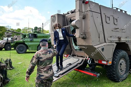Stock Image of French Defense Minister Florence Parly steps down from an armoured vehicle during a visit to the military camp of Satory in Versailles-Satory, west of Paris