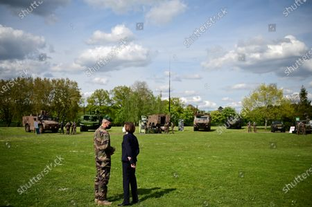 French Defense Minister Florence Parly talks with French Army chief of staff General Thierry Burkhard during a visit to the military camp of Satory in Versailles-Satory, west of Paris