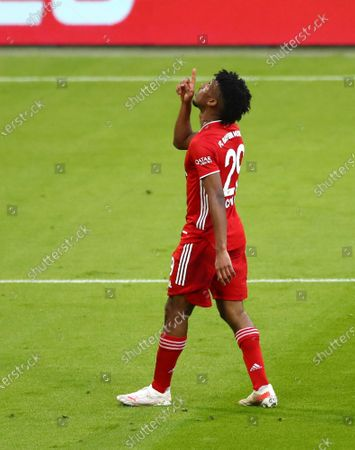 Bayern's Kingsley Coman celebrates after scoring his side's fourth goal during the German Bundesliga soccer match between Bayern Munich and Borussia Moenchengladbach at the Allianz Arena stadium in Munich, Germany