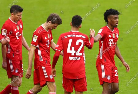 Stock Photo of Bayern's Kingsley Coman, right, celebrates with teammates after scoring his side's fourth goal during the German Bundesliga soccer match between Bayern Munich and Borussia Moenchengladbach at the Allianz Arena stadium in Munich, Germany