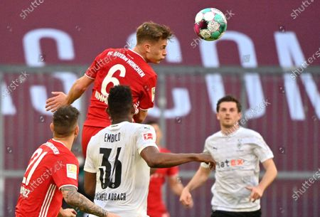 Bayern's Joshua Kimmich heads the ball during the German Bundesliga soccer match between Bayern Munich and Borussia Moenchengladbach at the Allianz Arena stadium in Munich, Germany
