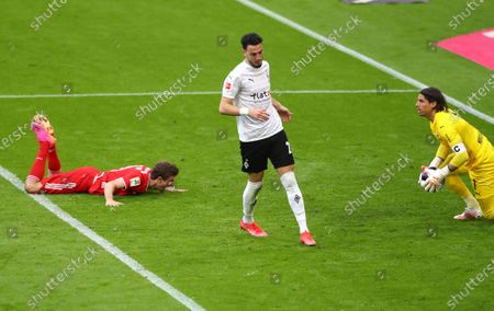 Bayern's Thomas Mueller, left, reacts as Moenchengladbach's goalkeeper Yann Sommer makes a save during the German Bundesliga soccer match between Bayern Munich and Borussia Moenchengladbach at the Allianz Arena stadium in Munich, Germany