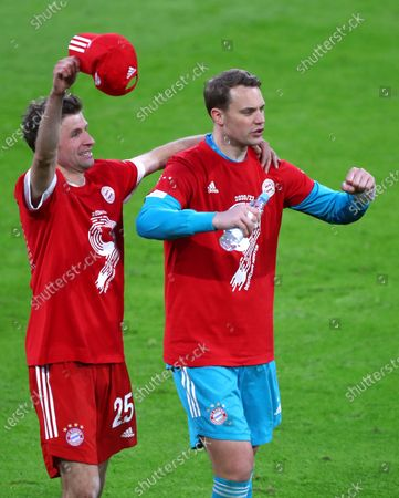 Bayern's Thomas Mueller, left, and Bayern's goalkeeper Manuel Neuer celebrate at the end of the German Bundesliga soccer match between Bayern Munich and Borussia Moenchengladbach at the Allianz Arena stadium in Munich, Germany