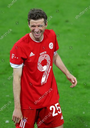 Bayern's Thomas Mueller celebrates at the end of the German Bundesliga soccer match between Bayern Munich and Borussia Moenchengladbach at the Allianz Arena stadium in Munich, Germany