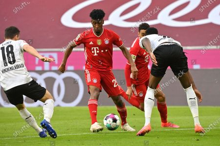 Stock Picture of Bayern's Kingsley Coman, centre, in action during the German Bundesliga soccer match between Bayern Munich and Borussia Moenchengladbach at the Allianz Arena stadium in Munich, Germany