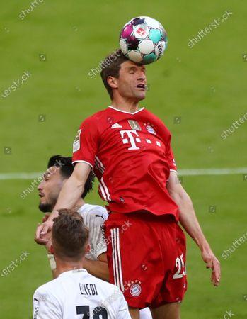 Bayern's Thomas Mueller heads the ball during the German Bundesliga soccer match between Bayern Munich and Borussia Moenchengladbach at the Allianz Arena stadium in Munich, Germany