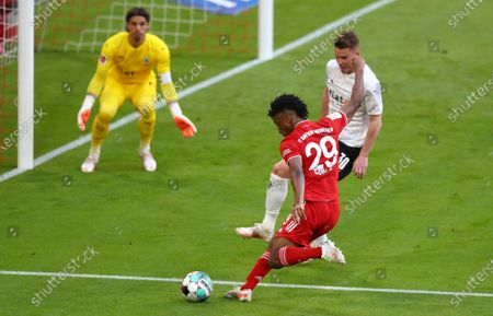 Bayern's Kingsley Coman makes an attempt to score during the German Bundesliga soccer match between Bayern Munich and Borussia Moenchengladbach at the Allianz Arena stadium in Munich, Germany