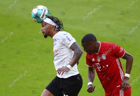 Stock Picture of Moenchengladbach's Valentino Lazaro, left, and Bayern's David Alaba challenge for the ball during the German Bundesliga soccer match between Bayern Munich and Borussia Moenchengladbach at the Allianz Arena stadium in Munich, Germany