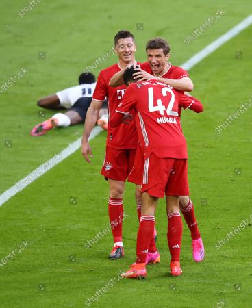 Bayern's Thomas Mueller, centre, celebrates after scoring his side's second goal during the German Bundesliga soccer match between Bayern Munich and Borussia Moenchengladbach at the Allianz Arena stadium in Munich, Germany