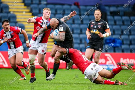 Castleford's Nathan Massey is tackled by Salford's Danny Addy and Sebastine Ikahihifo.
