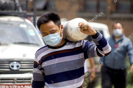Relatives queue outside an Oxygen facility, Kathmandu