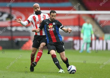 Stock Picture of Crystal Palace's Luka Milivojevic battles with David McGoldrick of Sheffield United