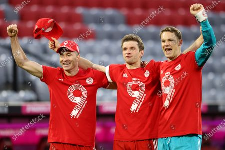 Robert Lewandowski, Thomas Mueller and Manuel Neuer of FC Bayern Muenchen celebrates winning the Bundesliga title after the Bundesliga match between FC Bayern Muenchen and Borussia Moenchengladbach at Allianz Arena in Munich, Germany, 08 May 2021.