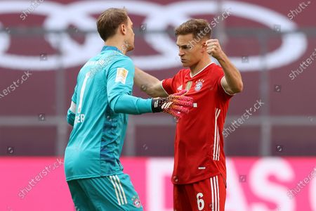 Manuel Neuer (L) and Joshua Kimmich of FC Bayern Muenchen interact prior to the Bundesliga match between FC Bayern Muenchen and Borussia Moenchengladbach at Allianz Arena in Munich, Germany, 08 May 2021.