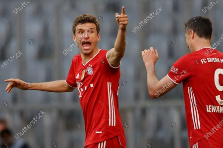 Thomas Mueller of FC Bayern Muenchen celebrates after scoring their side's second goal  during the Bundesliga match between FC Bayern Muenchen and Borussia Moenchengladbach at Allianz Arena in Munich, Germany, 08 May 2021.