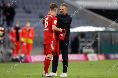 Hans-Dieter Flick, Head Coach of FC Bayern Muenchen celebrates victory with Joshua Kimmich after the Bundesliga match between FC Bayern Muenchen and Borussia Moenchengladbach at Allianz Arena in Munich, Germany, 08 May 2021.