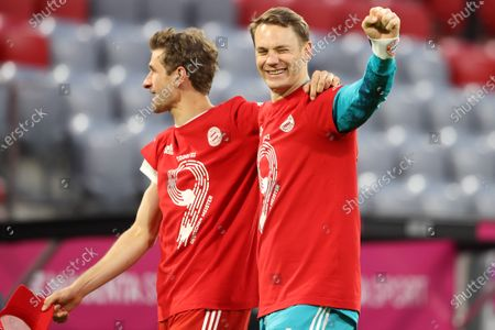 Thomas Mueller and Manuel Neuer of FC Bayern Muenchen celebrates winning the Bundesliga title after the Bundesliga match between FC Bayern Muenchen and Borussia Moenchengladbach at Allianz Arena in Munich, Germany, 08 May 2021.