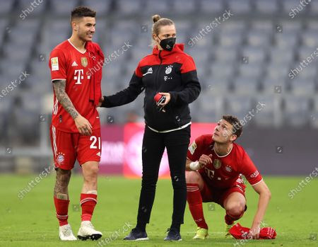 Lucas Hernandez and Benjamin Pavard of FC Bayern Muenchen celebrate their side's victory and winning the Bundesliga title after the Bundesliga match between FC Bayern Muenchen and Borussia Moenchengladbach at Allianz Arena in Munich, Germany, 08 May 2021.