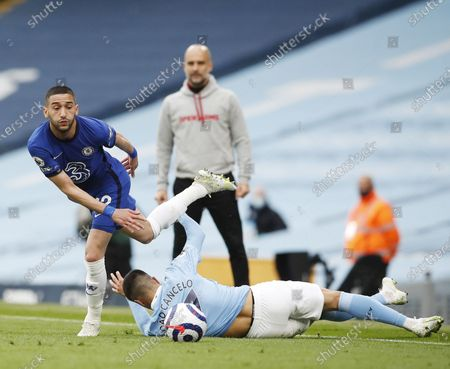 Joao Cancelo of Manchester City (R) in action against Hakim Ziyech of Chelsea (L) during the English Premier League soccer match between Manchester City and Chelsea FC in Manchester, Britain, 08 May 2021.