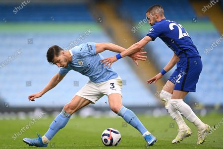 Manchester City's Ruben Dias (L) in action against Chelsea's Hakim Ziyech (R) during the English Premier League soccer match between Manchester City and Chelsea FC in Manchester, Britain, 08 May 2021.