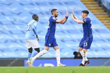 Chelsea's Hakim Ziyech (C) celebrates with Billy Gilmour (R) after scoring the 1-1 equalizer during the English Premier League soccer match between Manchester City and Chelsea FC in Manchester, Britain, 08 May 2021.