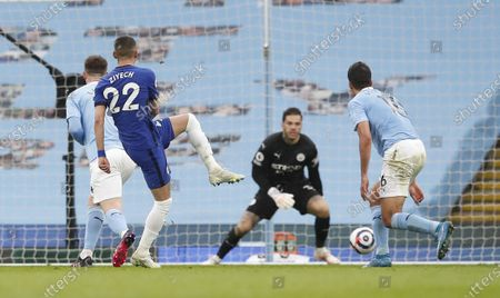 Hakim Ziyech of Chelsea (C) scores his team's opening goal during the English Premier League soccer match between Manchester City and Chelsea FC in Manchester, Britain, 08 May 2021.