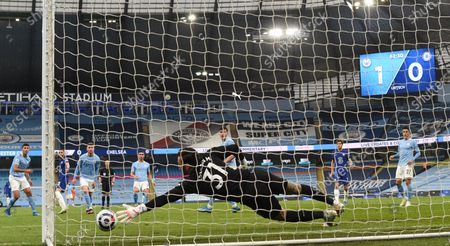 Hakim Ziyech of Chelsea scores his team's opening goal during the English Premier League soccer match between Manchester City and Chelsea FC in Manchester, Britain, 08 May 2021.