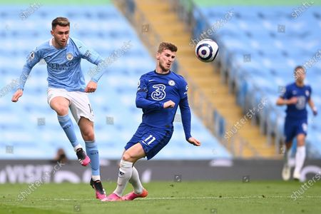 Manchester City's Aymeric Laporte (L) in action against Chelsea's Timo Werner (R) during the English Premier League soccer match between Manchester City and Chelsea FC in Manchester, Britain, 08 May 2021.