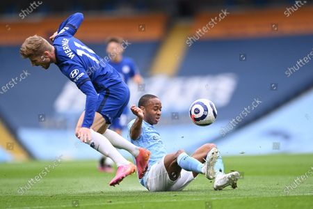 Manchester City's Raheem Sterling (R) in action against Chelsea's Timo Werner (L) during the English Premier League soccer match between Manchester City and Chelsea FC in Manchester, Britain, 08 May 2021.