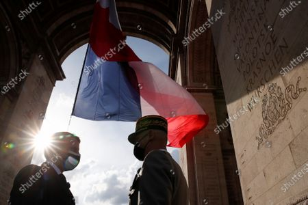French President Emmanuel Macron speaks with General Francois Lecointre during a ceremony to mark the end of World War II at the Arc de Triomphe in Paris, France, 08 May 2021.