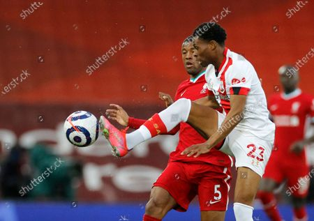 Stock Photo of Southampton's Nathan Tella, right, duels for the ball with Liverpool's Georginio Wijnaldum during the English Premier League soccer match between Liverpool and Southampton at Anfield stadium in Liverpool, England