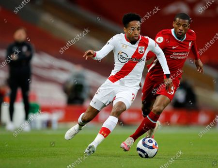 Southampton's Kyle Walker-Peters, left, duels for the ball with Liverpool's Georginio Wijnaldum during the English Premier League soccer match between Liverpool and Southampton at Anfield stadium in Liverpool, England