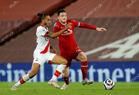 Southampton's Theo Walcott, left, duels for the ball with Liverpool's Andrew Robertson during the English Premier League soccer match between Liverpool and Southampton at Anfield stadium in Liverpool, England