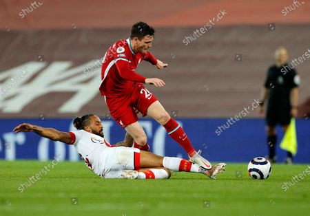 Stock Picture of Southampton's Theo Walcott, left, duels for the ball with Liverpool's Andrew Robertson during the English Premier League soccer match between Liverpool and Southampton at Anfield stadium in Liverpool, England