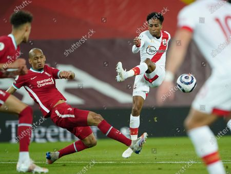 Liverpool's Fabinho, second left, tries to block a shot from Southampton's Kyle Walker-Peters during the English Premier League soccer match between Liverpool and Southampton at Anfield stadium in Liverpool, England
