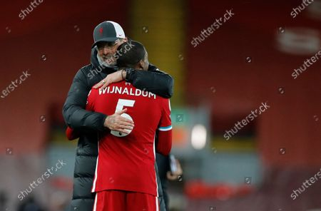 Stock Picture of Liverpool's manager Jurgen Klopp celebrates with Liverpool's Georginio Wijnaldum at the end of the English Premier League soccer match between Liverpool and Southampton at Anfield stadium in Liverpool, England