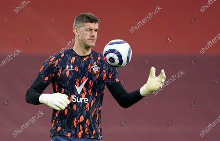 Southampton goalkeeper Fraser Forster during warm up before the English Premier League soccer match between Liverpool and Southampton at Anfield stadium in Liverpool, England