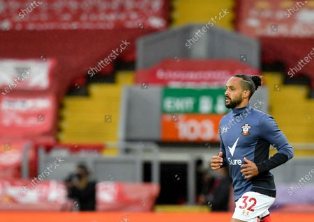 Stock Photo of Southampton's Theo Walcott runs during warm up before the English Premier League soccer match between Liverpool and Southampton at Anfield stadium in Liverpool, England
