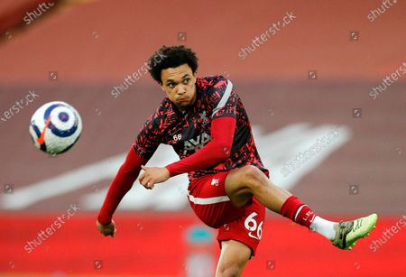 Liverpool's Trent Alexander-Arnold kicks the ball during warm up before the English Premier League soccer match between Liverpool and Southampton at Anfield stadium in Liverpool, England