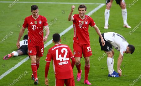 Bayern's Thomas Mueller (2-R) celebrates his 2-0 goal during  the German Bundesliga soccer match between FC Bayern Munich and Borussia Moenchengladbach in Munich, Germany, 08 May 2021.