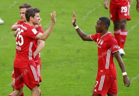 Bayern's Thomas Mueller (2-L) celebrates his 2-0 goal during  the German Bundesliga soccer match between FC Bayern Munich and Borussia Moenchengladbach in Munich, Germany, 08 May 2021.