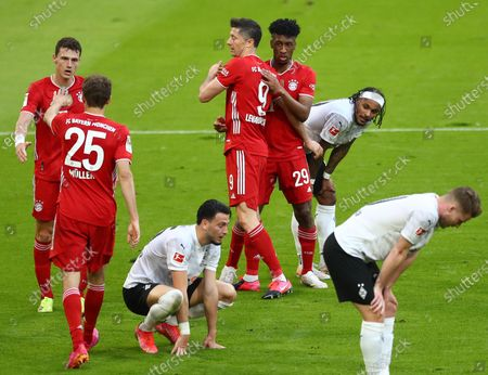 Bayern's Kingsley Coman (3-R) celebrates his 4-0 goal during  the German Bundesliga soccer match between FC Bayern Munich and Borussia Moenchengladbach in Munich, Germany, 08 May 2021.