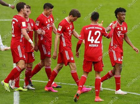 Bayern's Kingsley Coman (R) celebrates his 4-0 goal during  the German Bundesliga soccer match between FC Bayern Munich and Borussia Moenchengladbach in Munich, Germany, 08 May 2021.