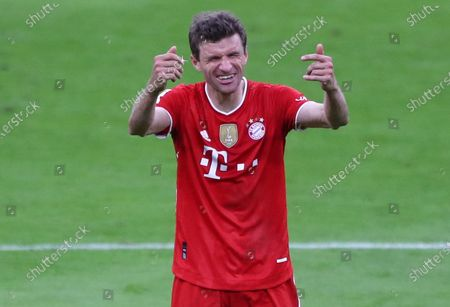 Stock Photo of Bayern's Thomas Mueller celebrates winning  the German Bundesliga soccer match between FC Bayern Munich and Borussia Moenchengladbach in Munich, Germany, 08 May 2021.