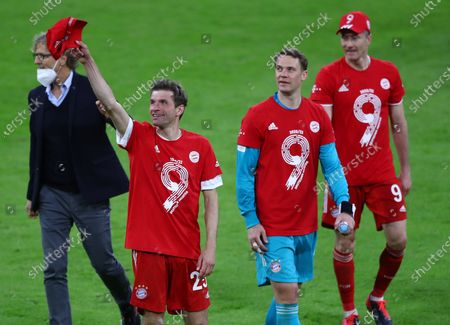 Bayern's Thomas Mueller (L), Bayern's goalkeeper Manuel Neuer (C) and Bayern's Robert Lewandowski (R) celebrate after winning  the German Bundesliga title after the match between FC Bayern Munich and Borussia Moenchengladbach in Munich, Germany, 08 May 2021.